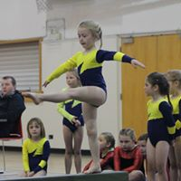 A young West Melton gymnast competing in Beam