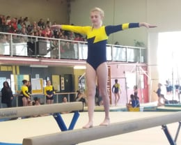 Tamzin competing in Beam at the 2018 CSG Competition
